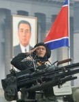 A North Korean participant on a military vehicle salutes in Pyongyang