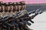 Soldiers march during a military parade to commemorate the 65th anniversary of founding of the Workers' Party of Korea in Pyongyang