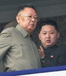 North Korean leader Kim Jong-il walks in front of his youngest son Kim Jong-un during a parade in Pyongyang