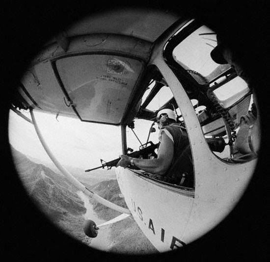 Pilot Holding M16 Rifle