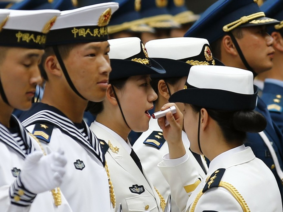 Female honour guard has lipstick applied as they prepare for an official welcoming ceremony for Bangladesh Prime Minister Sheikh Hasina, hosted by China's Premier Li Keqiang, at the Great Hall of the People in Beijing