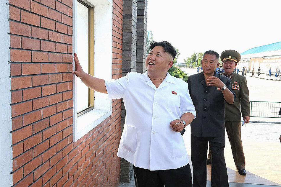 North Korean leader Kim Jong Un provides field guidance during his visit to the Chollima Tile Factory