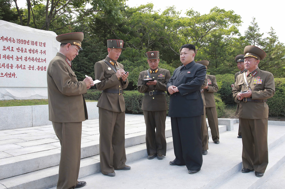 KCNA handout shows North Korean leader Kim Jong Un carrying out inspection of Hwa Islet Defence Detachment off east coast of Korean peninsula