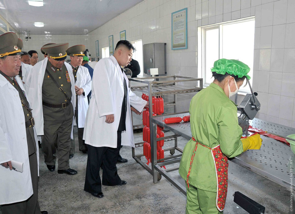 KCNA picture shows North Korean leader Kim Jong-un visiting a pig factory of the 549th unit of the Korean People's Army at an undisclosed location